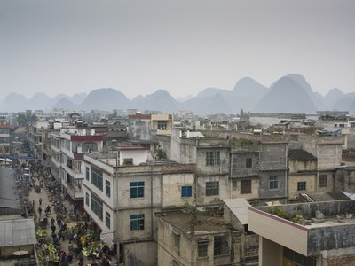 Guilin, Guangxi Province, China, Aerial view of buildings with mountains in background Fine Art Print by Assaf Frank
