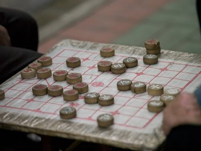 People playing game, close-up, South china Fine Art Print by Assaf Frank