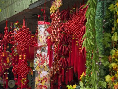 Chinese New Year Decorations in market, close-up Fine Art Print by Assaf Frank