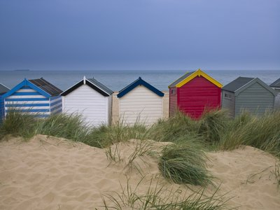 Beach huts in a row Poster Art Print by Assaf Frank