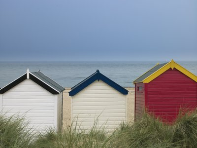 Beach huts in a row Wall Art & Canvas Prints by Assaf Frank