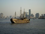 An old boat running on the Huangpu river during the daybreak time. Fine Art Print by Assaf Frank