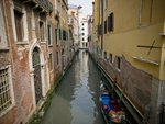 Italy, Boat in canal by building Fine Art Print by Assaf Frank