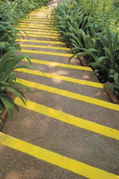 Winding steps fluorescent yellow stripes and bordering lily leaves bend gracefully, Phuket Fine Art Print by Anonymous