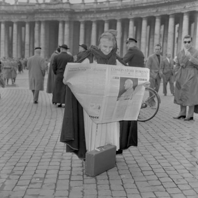 A woman reads the news of the election of Pope John XXIII, Vatican City, 4th November 1958 Wall Art & Canvas Prints by Anonymous