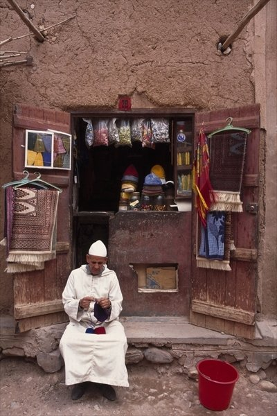 Vendor knitting, Taouit Fine Art Print by Anonymous