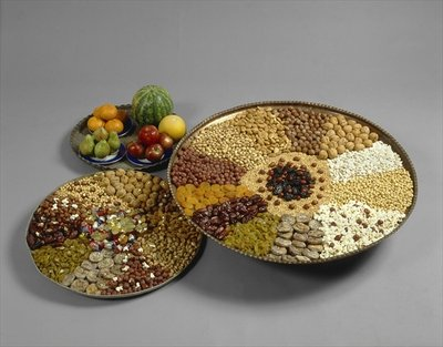 Tu B'shvat trays with nuts and dried fruits, 1997 Fine Art Print by Anonymous