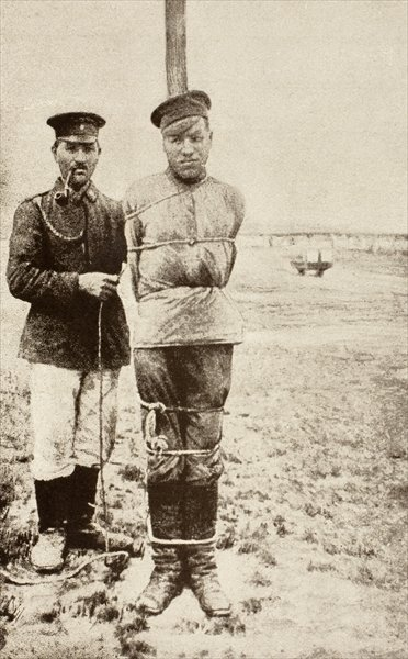 A First World War Russian prisoner of war tied to a pole, from 'L'Illustration', published in 1917 Fine Art Print by French School