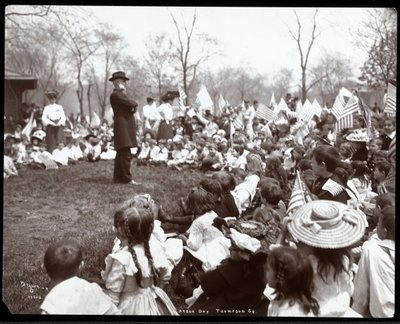Children watching an entertainer on Arbor Day at Tompkins Square Park, New York, 1904 Postcards, Greetings Cards, Art Prints, Canvas, Framed Pictures, T-shirts & Wall Art by Byron Company
