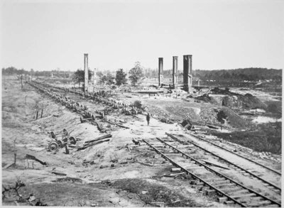 Ruins of Hood's 28-car ammunition train and the Scofield Rolling Mill, near Atlanta, Georgia, September 1864 Fine Art Print by G.N. Barnard