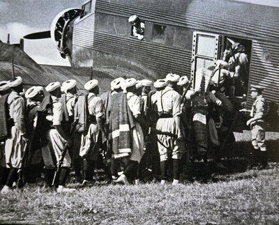 Moroccan soldiers of General Franco's army board a German Junkers Ju 52 air transport to Spain, 1936 Fine Art Print by Spanish Photographer