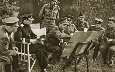 Lieutenant General Dempsey, Commander of the British Second Army, explains to Soviet officers the state of affairs on the Western Front, 1944 Fine Art Print by English Photographer