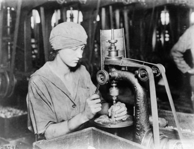 Woman countersinking detonator tube hole and filling hole in hand grenade at Westinghouse Electric & Mfg. Co., East Pittsburgh, Pa., during World War I, 1914-18 (b/w photo) Fine Art Print by American Photographer