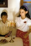 Children lighting the Hannukah lights Fine Art Print by Clive Uptton