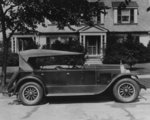 DuPont automobile on front of house, c.1919-30 (b/w photo) Fine Art Print by American School