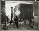 A man spraypainting a delivery wagon of the Carolyn Laundry at 111 East 128th Street, East Harlem, New York, 1929 Fine Art Print by Byron Company