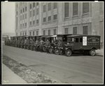 A line of delivery trucks parked outside the Carolyn Laundry at 111 East 128th Street, East Harlem, New York, 1929 Fine Art Print by Byron Company