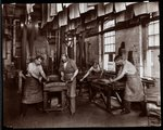 Interior view of men working on leather at the New York Leather Belting Co., New York, 1905-06 Fine Art Print by Umberto Boccioni