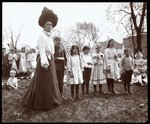 Woman with children holding flags on Arbor Day at Tompkins Square Park, New York, 1904 Fine Art Print by Byron Company