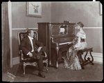 Man and woman playing a player piano, New York, 1907 Fine Art Print by Byron Company