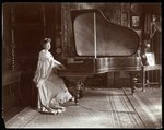 Mrs. I. M. Clark seated at a gran piano, 1904 Fine Art Print by Lincoln Seligman