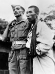 An Indian Army medic helping a wounded Japanese prisoner of war, 1945 Fine Art Print by English Photographer