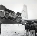 Unloading a jeep from Douglas 'Skymaster' at Shanghai airport, China, during the Second World War Fine Art Print by French School