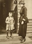 East End child with a policewoman Fine Art Print by John Thomson