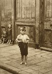 Barefoot child on a London street Poster Art Print by John Thomson