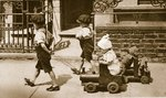 Children play on the street: boys pulling carts Fine Art Print by English Photographer