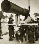 A V-1 flying bomb is hoisted onto its launcher, 1944 Postcards, Greetings Cards, Art Prints, Canvas, Framed Pictures, T-shirts & Wall Art by English School
