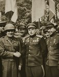 On 25th April 1945 the American First Army met the Soviet forces of Marshal Konev at Torgau, on the Elbe. Major General Reinhardt shakes hands with Marshal Konev Fine Art Print by English Photographer