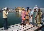 A photographer at the Golden Temple records a family's visit Fine Art Print by Shanti Panchal