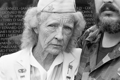 Evelyn Barbour visiting the Vietnam Veterans Memorial by Michael Katakis - print