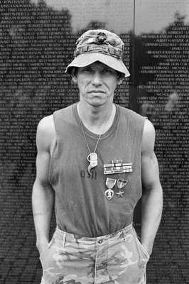 A decorated marine visits the Vietnam Veterans Memorial by Michael Katakis - print