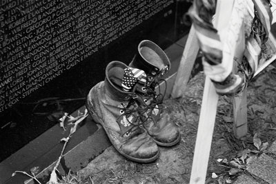 Combat boots at the Vietnam Veterans Memorial by Michael Katakis - print
