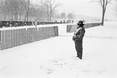 Veteran in the snow at the Vietnam Veterans Memorial by Michael Katakis - print
