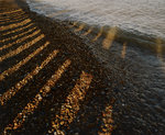 Wave breaking on shingle shore by Fay Godwin - print