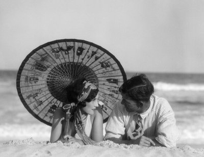 1920s Romantic Couple Looking At One Another Laying Face To Face Under Parasol On Sandy Beach Wall Art & Canvas Prints by H. Armstrong Roberts
