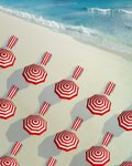 Deckchairs and sunshades in a raw at beach Wall Art & Canvas Prints by Simon Cook