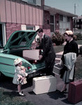 1950s Family Mother Father Daughter In Front Of Suburban House Packing Luggage In Car For Vacation Postcards, Greetings Cards, Art Prints, Canvas, Framed Pictures & Wall Art by Peter Miller