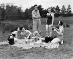 1930s group of five young men & women enjoying picnic in woods all but one wearing swimsuits Wall Art & Canvas Prints by Lincoln Seligman