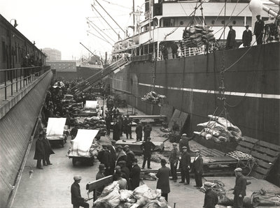 Cargo being loaded or unloaded from a ship, Royal Victoria Dock, Canning Town, London Fine Art Print by Anonymous