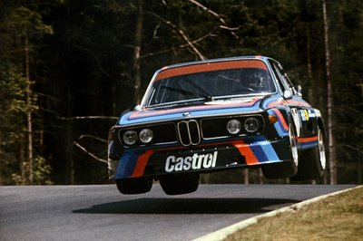1974 Nurburgring, Germany. 14th July 1974 Hans Joachim Stuck takes off in the BMW 3.5 CSL he shared with Ronnie Peterson Fine Art Print by Anonymous