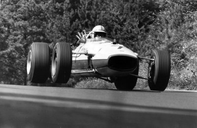 1967 German Grand Prix. Nurburgring, Germany. 6 August 1967. John Surtees, Honda RA273, 4th position, jump, action. Fine Art Print by Anonymous