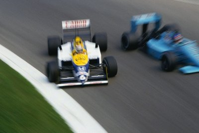 1987 Italian Grand Prix. Monza, Italy. 4-6 September 1987. Nelson Piquet (Williams FW11B-Honda), 1st position, gets sideways as he passes Ivan Capelli (March 871-Ford) at the Parabolica. Wall Art & Canvas Prints by Anonymous