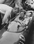 1962 German Grand Prix. Nurburgring, Germany. 3-5 August 1962. Jim Clark (Team Lotus) sits in the rival Ferrari Dino 156 car and inspects things with his team boss Colin Chapman. Wall Art & Canvas Prints by Anonymous