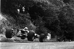 1967 German Grand Prix. Nurburgring, Germany. 6 August 1967. Jochen Rindt, Cooper T86-Maserati, retired, watches a car jump at the Flugplatz, action. Fine Art Print by Anonymous