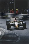 1994 Monaco Grand Prix, Monte Carlo. Johnny Herbert (Lotus 107C-Mugen) lifts a wheel at Mirabeau