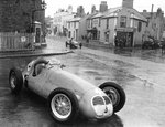 1949 Jersey Road Race, St Helier, Fred Ashmore passes the retired car of Reg Parnell, both Maserati 4CLT/48. Ashmore finished in 5th position